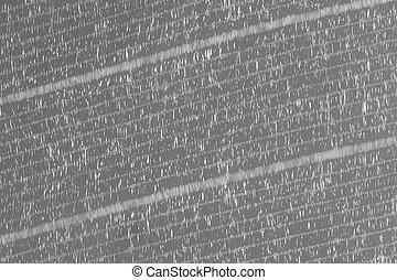blurred black plastic mesh