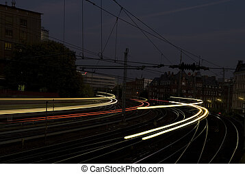 abstract of fast trains passing by at night