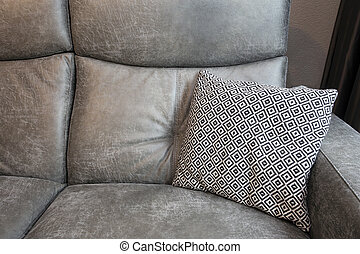 Abstract of Grey leather Sofa and black and white Pillows in modern living room background texture