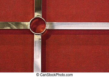 metal cross on the red carpet