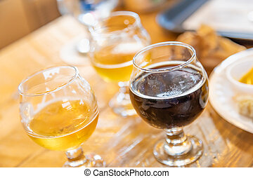 Abstract of Small Glass of Micro Brew Beers On Bar.