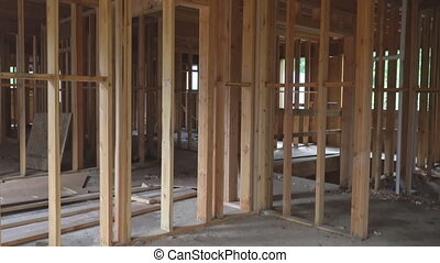 Abstract of Wood Home Framing at Construction Site. Building...