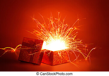 Open gold gift box and light fireworks christmas on red background, Merry Christmas and Happy New Year
