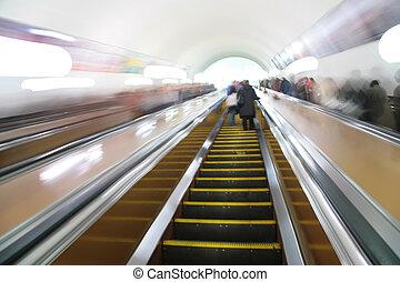 abstract passengers on escalator. motion blur