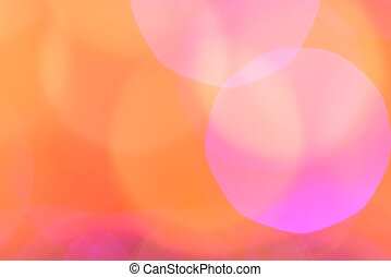 Abstract pink and orange bokeh background