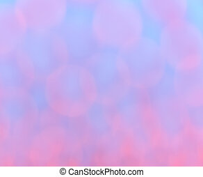 Abstract pink bokeh on blue background