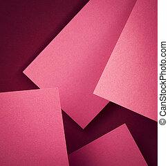 Pink paper on burgundy background