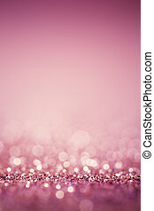 Abstract pink twinkled bright background with bokeh defocused lights.