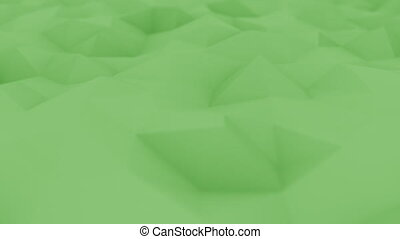 Abstract polygonal green surface, shallow focus close-up. Loopable motion background