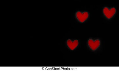 abstract real red hearts bokeh on black background, congratulation greeting valentine day and love concept