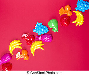 abstract red background with childrens plastic toys