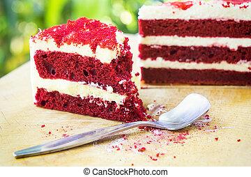 abstract red velvet cake on wood block and light green bokeh