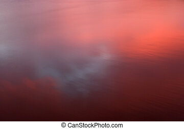 Abstract Reflection - Photo of a sunset reflected in wet...