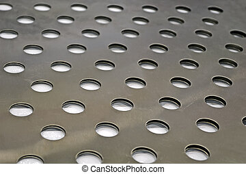abstract round holes on metal surface, industry details