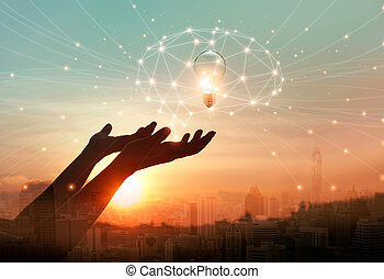 Abstract science. Hand holding brain digital network and light bulb inside on networking connection in the city background. Idea and imagination. Creative and inspiration. Innovation technology