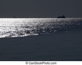 Abstract shining ocean with ocean liner at dusk time