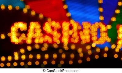 Video Full HD - Abstract bokeh effect from this slightly unfocused shot of a casino's flashy, brightly colored, neon sign at night.