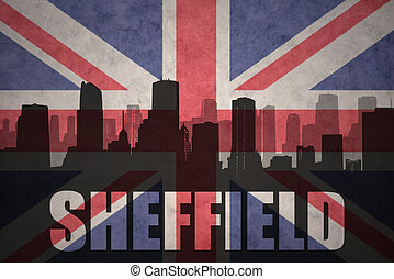 abstract silhouette of the city with text Sheffield at the vintage british flag