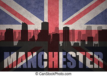 abstract silhouette of the city with text Manchester at the vintage british flag