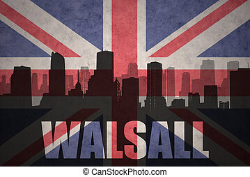 abstract silhouette of the city with text Walsall at the vintage british flag