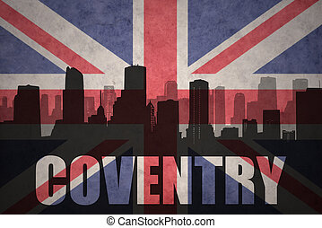 abstract silhouette of the city with text Coventry at the vintage british flag