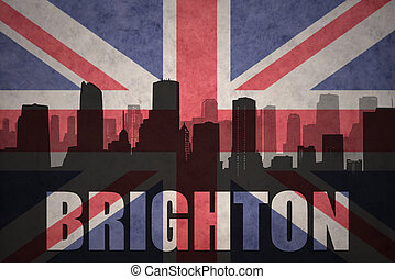 abstract silhouette of the city with text Brighton at the vintage british flag