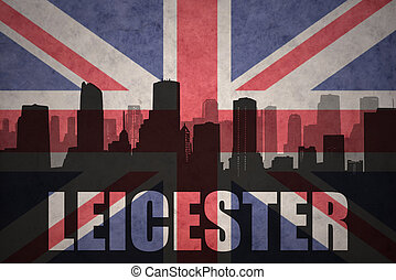 abstract silhouette of the city with text Leicester at the vintage british flag