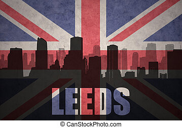 abstract silhouette of the city with text Leeds at the vintage british flag