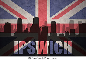 abstract silhouette of the city with text Ipswich at the vintage british flag