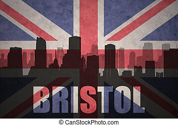 abstract silhouette of the city with text Bristol at the vintage british flag
