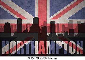 abstract silhouette of the city with text Northampton at the vintage british flag