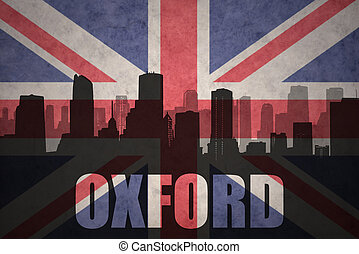 abstract silhouette of the city with text Oxford at the vintage british flag