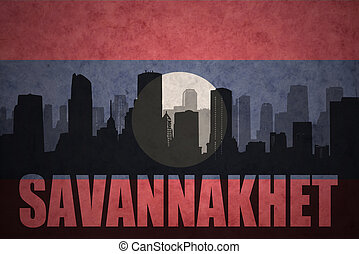 abstract silhouette of the city with text Savannakhet at the vintage laotian flag background