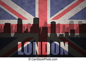 abstract silhouette of the city with text London at the vintage british flag
