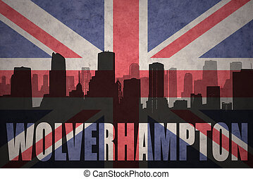 abstract silhouette of the city with text Wolverhampton at the vintage british flag