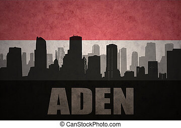 abstract silhouette of the city with text Aden at the vintage yemen flag background