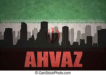 abstract silhouette of the city with text Ahvaz at the vintage iranian flag background