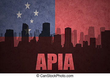 abstract silhouette of the city with text Apia at the vintage Samoa flag