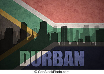 abstract silhouette of the city with text Durban at the vintage south africa flag