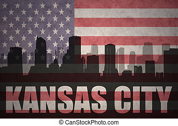 abstract silhouette of the city with text Kansas City at the vintage american flag
