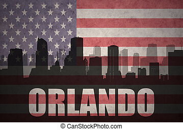 abstract silhouette of the city with text Orlando at the vintage american flag
