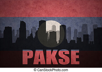 abstract silhouette of the city with text Pakse at the vintage laotian flag background