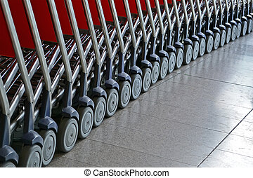 abstract silver small trolley with wheel heap for luggage transportation, airport details