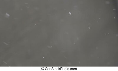 abstract Snow background. snow white background. snow texture in slow motion on grey background