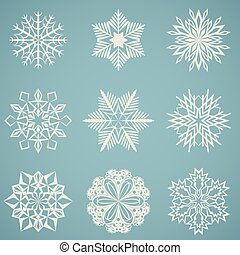 Abstract snowflake shapes isolated on blue background.