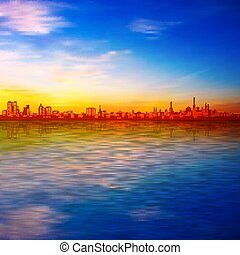 abstract spring sunset background with blue sky and silhouette of city