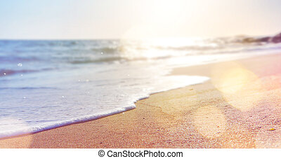 abstract summer background of blurred beach and sea waves