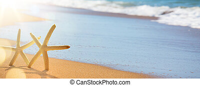 abstract summer vacation background of blurred beach and sea waves