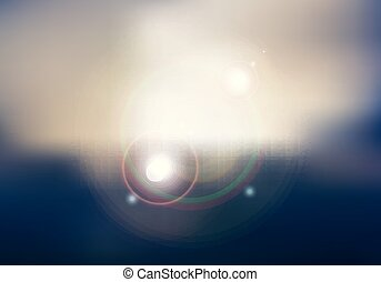 Abstract sunset or sunrise sky and sun shining blurred background with flare.