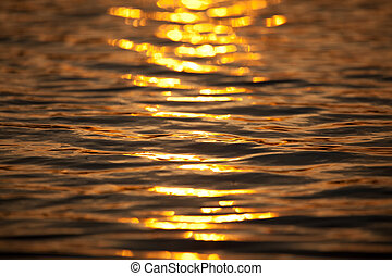 Abstract sunset reflection in the water of the lake